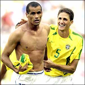 Rivaldo celebrates with Edmilson