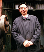 Mr Yin outside his first industrial plant