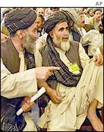 Delegates from Kandahar confer during the loya jirga