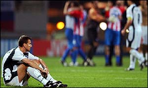 A dejected Zeljko Milinovic watches Paraguay celebrate