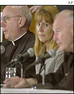 Archbishop Harry J. Flynn (L), Barbara Blaine of Survivors Network of Those Abused by Priests, and Cardinal Theodore McCarrick (R)