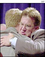 Victims Craig Martin (right) and David Clohessy hug