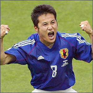 Japan's Hiroaki Morishima celebrates after scoring