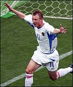 Vladimir Beschastnykh celebrates his equaliser for Russia