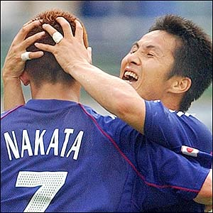 Japan's Hidetoshi Nakata is congratulated by Hiroaki Morishima after scoring Japan's second