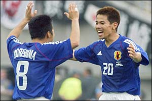 Japan's midfielder Hiroaki Morishima celebrates with Tomokazu Myojin at the final whistle