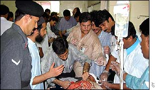 An injured man is attended to in a Karachi hospital