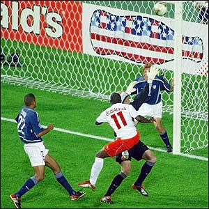 Poland shock the USA as Emmanuel Olisadebe blasts the ball into the net