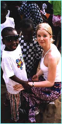 Becky meets a boy at a rescue centre for children in Togo