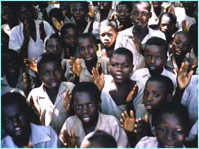 Children greet Newsround at a remote school in Togo