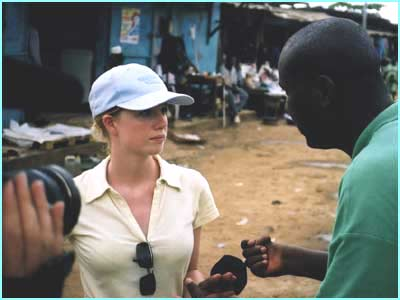 Recording an interview in a market where children work