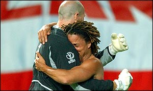 America's Cobi Jones (right) hugs Brad Friedel