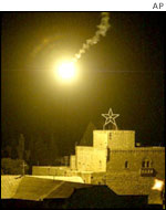 A flare is fired over Bethlehem's Church of the Nativity during the siege