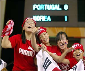 Korean fans at the stadium ( Photograph by Associated Press)
