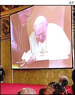 Pope John Paul II signs the declaration