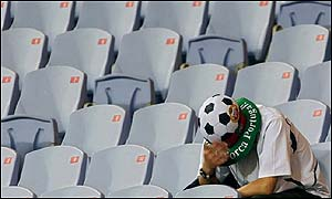 A lone Portugal fan is left disconsolate after the defeat that sealed his team's defeat