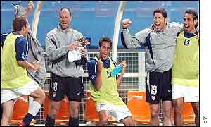 USA substitutes celebrate their progress