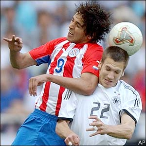 Paraguay's Roque Santa Cruz competes for the ball with Germany's Torsten Frings