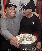 Scotty Bowman and Brett Hull celebrate in the locker room.