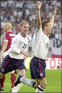Michael Owen celebrates his 22nd minute goal as Nicky Butt runs to congratulate the striker