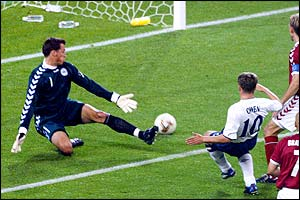 Michael Owen strikes to put England 2-0 up as Sorensen watches the ball roll into the back of the net