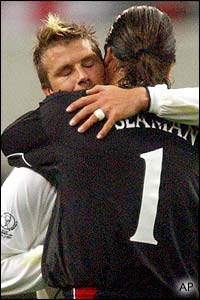 David Seaman celebrates victory with England skipper David Beckham, who leads his side into the quarter-finals