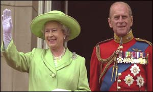 Queen Elizabeth and Prince Philip acknowledge the crowds