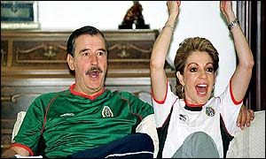 President Vicente Fox and his wife cheer Mexico through