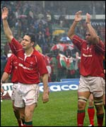 Stephen Jones and Colin Charvis salute the travelling Welsh support