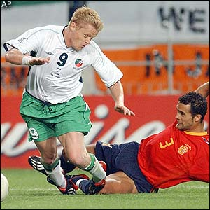 Damien Duff is brought down in the box by Spain's Juanfran