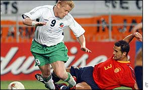 Damien Duff is brought down to win Ireland's first penalty