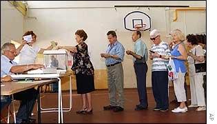 Voters queue in a Marseilles gymnasium