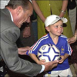 President Chirac with boy in French soccer kit