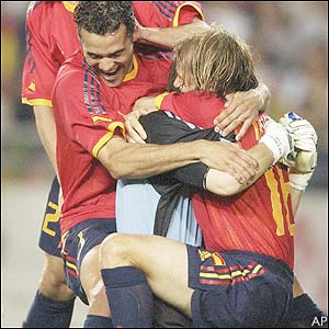 Spain's players celebrate their penalty success