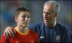 Republic of Ireland manager Mick McCarthy comforts Matt Holland
