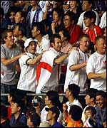 England fans conga round the stadium