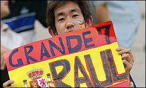 A Japanese fan holds up a banner supporting Raul
