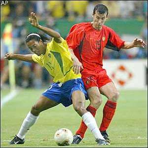 Brazil's Ronaldinho and Belgium's Jack Peeters battle for the ball
