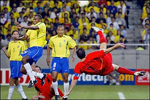 Belgium's Marc Wilmot's overhead kick troubles the Brazilian defence