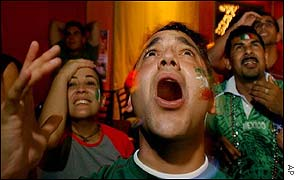Mexican fans react during while watching the match on television