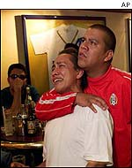 A Mexican fan breaks down as the result becomes apparent