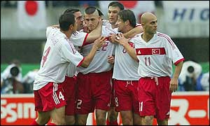 Turkey celebrate Umit Davala's decisive goal