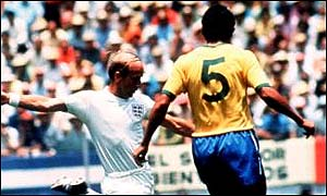England legend Bobby Charlton in white against Brazil in the 1970 World Cup