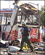An Israeli soldier at the bomb scene