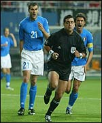 Italy's Christian Vieri bellows his anger at referee Byron Moreno, as does captain Paolo Maldini
