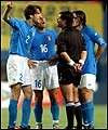 Ecuador referee Byron Moreno is surrounded by Italian players after sending off Francesco Totti