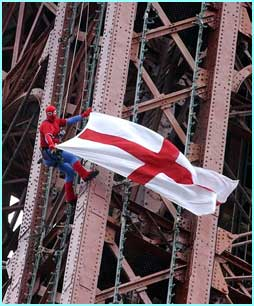 Alain wasn't the only one with this idea, David Hulme climbed Blackpool tower to hoist an England flag