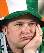 Dejected fan after Irish team's exit