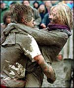 Revellers in the mud at Glastonbury 1997