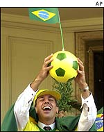 Brazil fan waves the flag for his country
